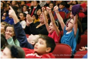 "Photo courtesy of John Sladewski/Standard-Times. Students react during the 2014 Young People's Con-certs, ""The Agents of the S.D.A."""